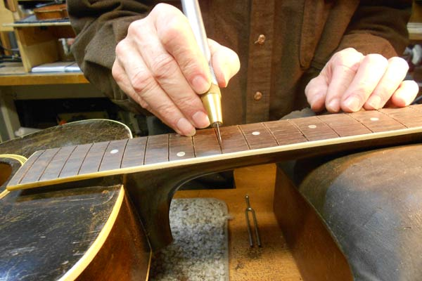 Arnie Gamble refret and bridge replace on Gibson arch top.
