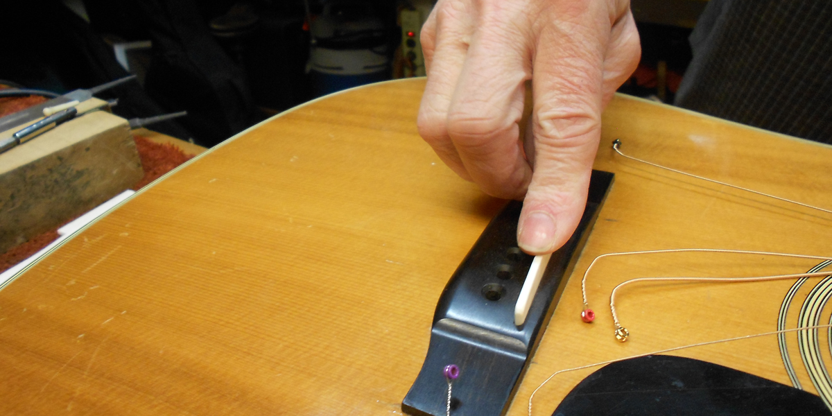 Arnie Gamble setting up a C. F. Martin guitar