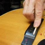 Arnie Gamble setting up a C. F. Martin guitar