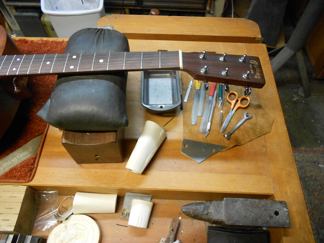 repairing a martin guitar head stock