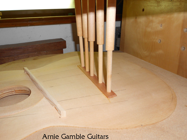 Gluing the bridge support on the top.