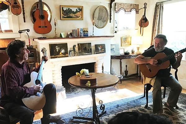 Arnie Gamble and Byron Tomingas playing guitars.