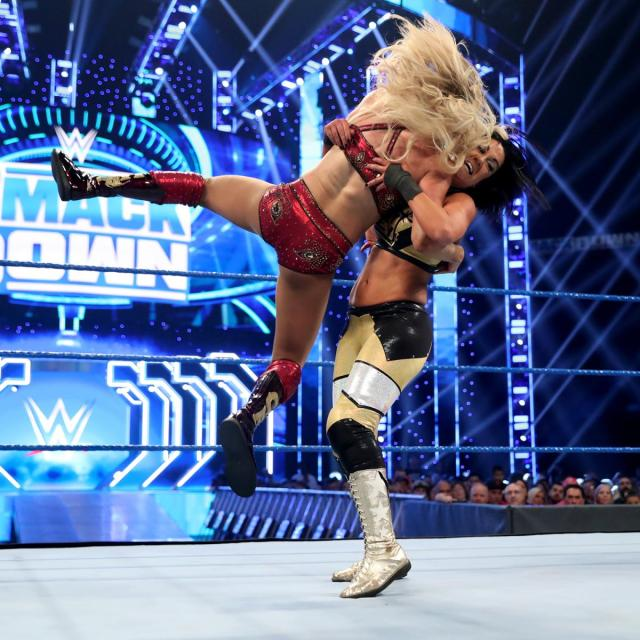 Charlotte Flair receives a Bayley to Belly