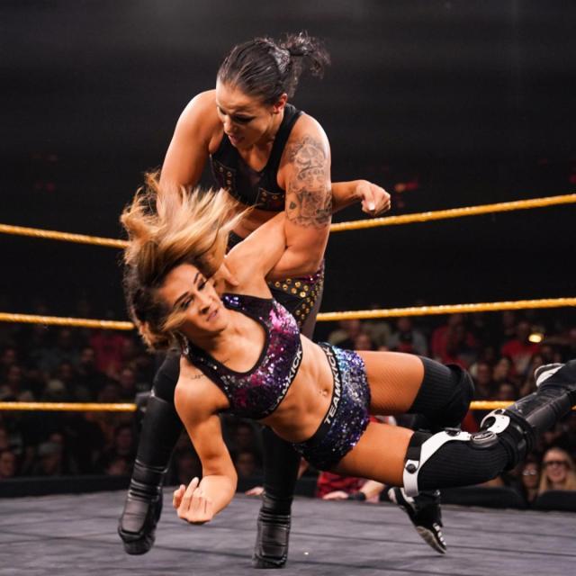Dakota Kai takes down Shayna Baszler with an arm-drag