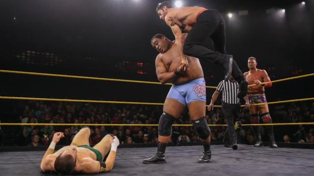 Keith Lee with Roderick Strong in the air. Kyle O'Reilly on the mat. Dominik Dijakovic in the background