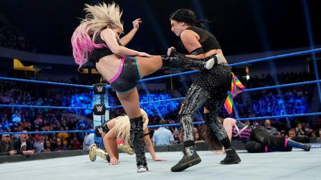 Alexa Bliss kicks Sonya Deville with Mandy Rose and Nikki Cross in the background