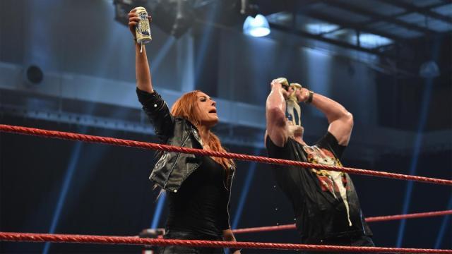 Becky Lynch poses with Steve Austin