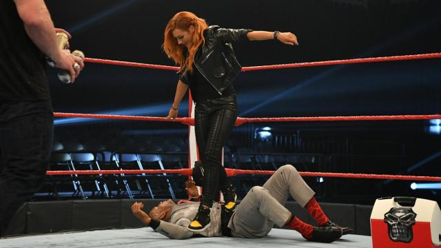 Becky Lynch steps on Byron Saxton getting into the ring