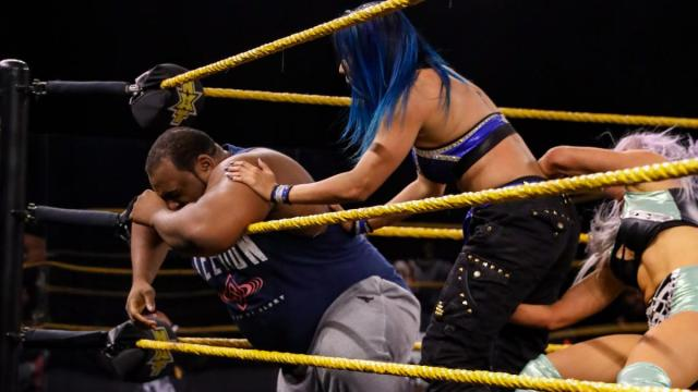 Candice LeRae sneaks up in Mia Yim while she's checking on Keith Lee