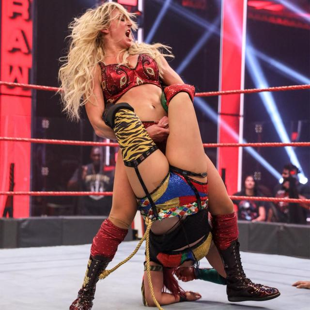 Charlotte Flair with Asuka in a Boston crab