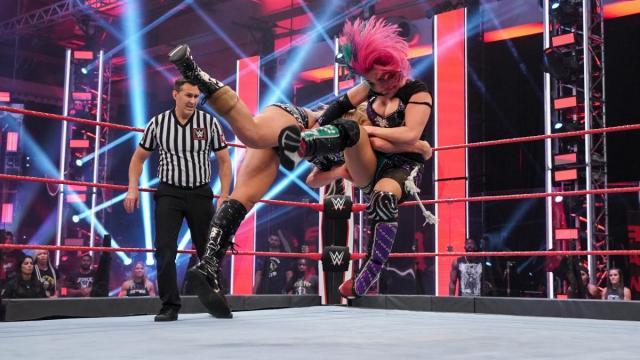 Charlotte Flair spears Asuka
