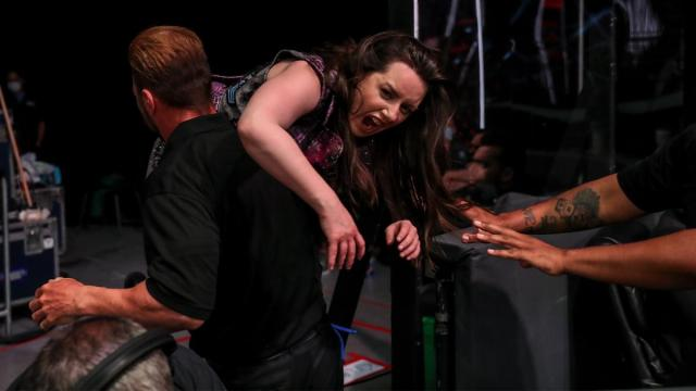 Nikki Cross is carried away by security