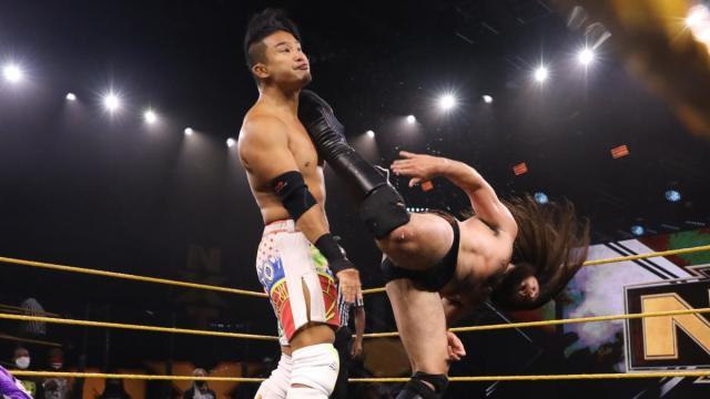 Cameron Grimes kicks Kushida in the head
