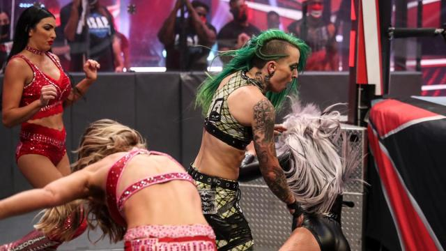 Peyton Royce shoves Ruby Riott into Liv Morgan