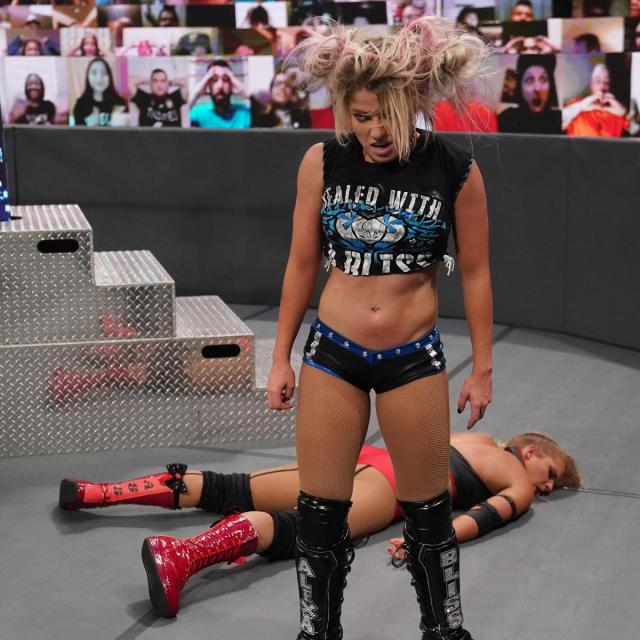 Alexa Bliss is wild-eyed after dropping Lacey Evans with a Sister Abigail
