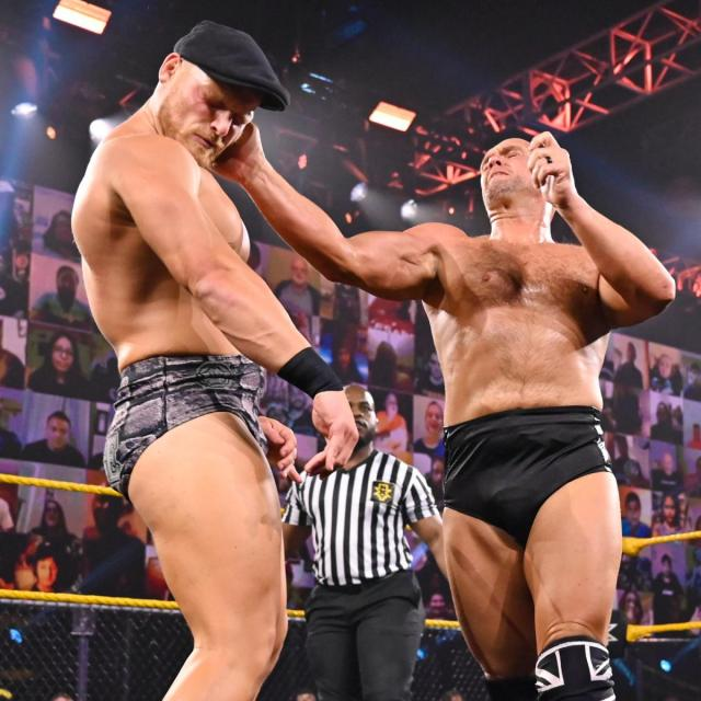 Danny Burch slaps Ridge Holland