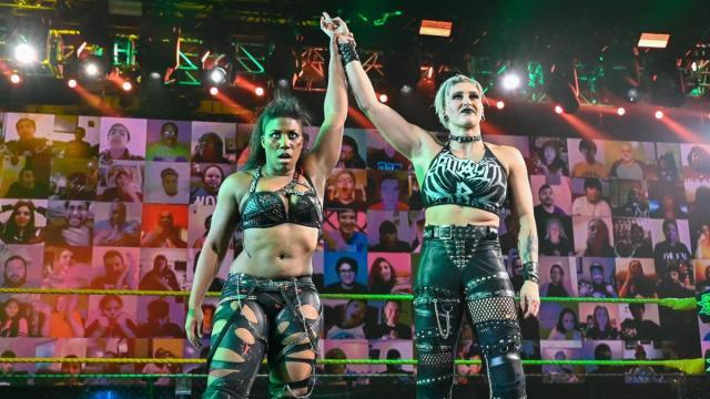 Ember Moon and Rhea Ripley celebrate beating Dakota Kai and Raquel Gonzalez