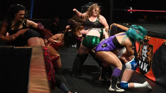 The NXT UK women's division brawl at ringside