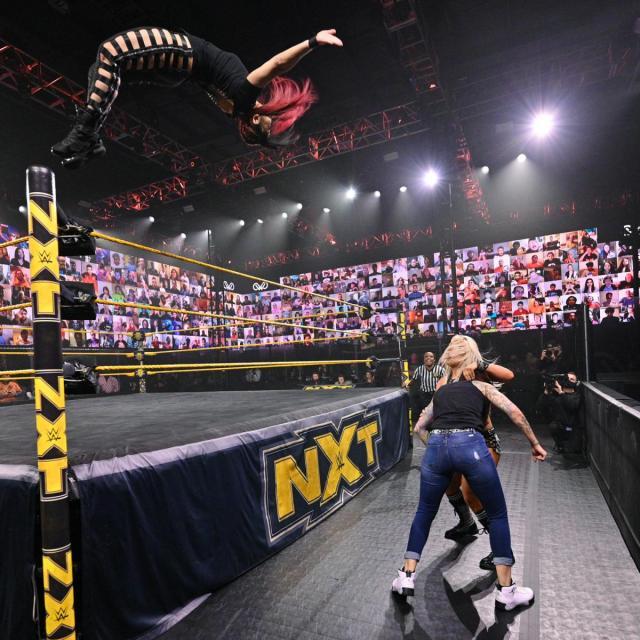 Io Shirai moonsaults onto Toni Storm and Mercedes Martinez