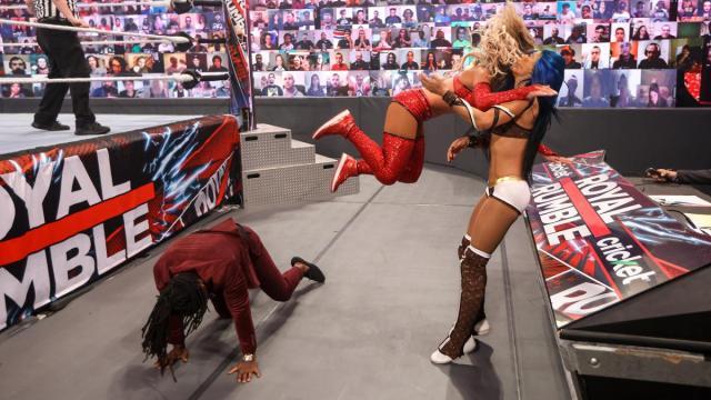 Carmella dives onto Sasha Banks after using Reginald as a springboard