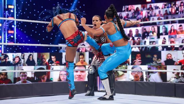 Sasha Banks and Bianca Belair kicking Shayna Baszler in the corner