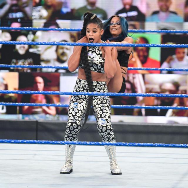 Sasha Banks gives Bianca Belair a backstabber