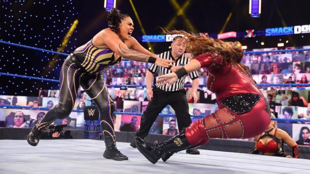 Tamina shoves Nia Jax over