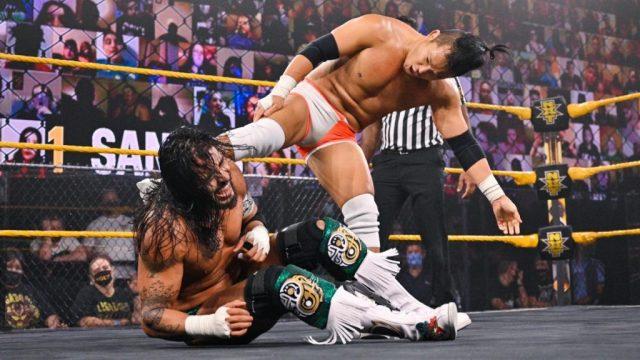 Kushida kicks Santos Escobar in the back