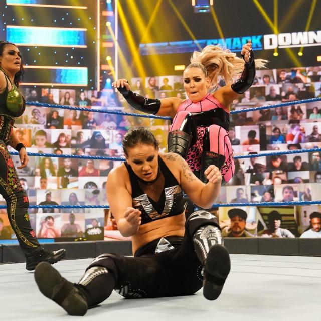 Natalya kicks Shayna Baszler in the back
