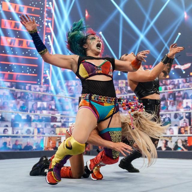 Charlotte Flair double chop blocks Asuka and Rhea Ripley