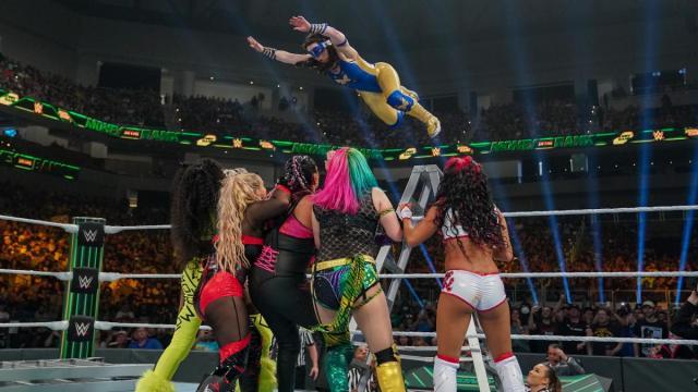Nikki A.S.H. flies from a ladder onto Naomi, Natalya, Tamina, Asuka, and Zelina Vega