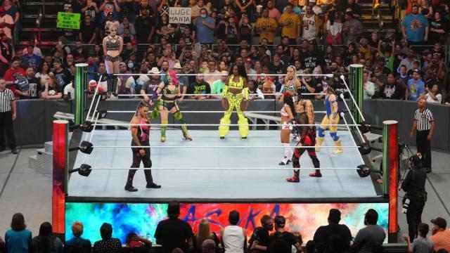 Alexa Bliss stood on the turnbuckle looking over Asuka, Natalya, Tamina, Naomi, Nikki A.S.H., Zelina Vega, and Liv Morgan at the start of the MITB ladder match