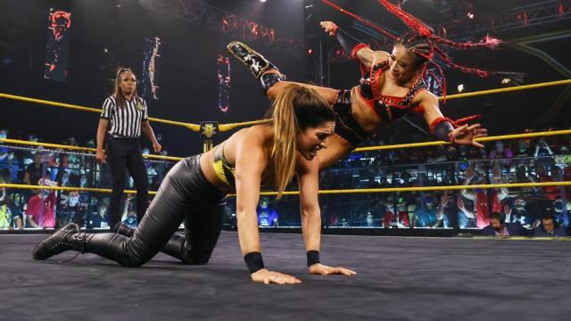 Xia Li kicks Raquel Gonzalez in the back