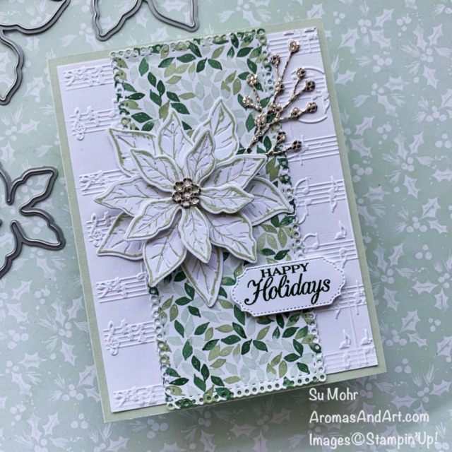 By Su Mohr for GDP 303; Click aromasandart.com to go to my website for details! Featuring: Poinsettia Petals Stamp Set, Poinsettia Dies, Ornate Frames Dies, Ornate layers Dies, Merry Melody Embossing Folder, Painted Christmas Designer Paper, Be Dazzling Specialty Paper; #christmascards #holidaycards #holiday2021 #merrymelody #paintedchristmas #bedazzling #poinsettiapetals #poinsettias #poinsettiasoncards #handmadecards #handcrafted #diy #cardmaking #papercrafting #stampinup #sumohr #aromasandart.com/shop #aromasandart.com