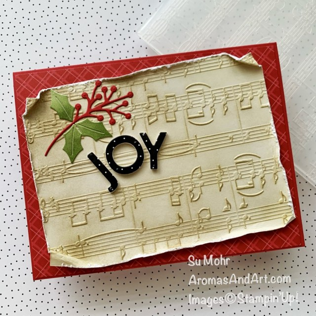 By Su Mohr for GDP 313; Click aromasandart.com to go to my website for instructions! Featuring: Merry melody Embossing Folder, Playful Alphabet Dies, Christmas Trimmings Dies, Blending Brushes; #joytotheworld #merrymelody #sheetmusic #musiconcards #alphabetdies #playfulalphabet #blendingbrushes #cardtechniques #handmadecards #handcrafted #diy #cardmaking #papercrafting #sumohr #aromasandart.com/shop #stamping #stampinup #gdp313