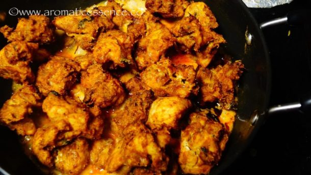 Add in the cooked chicken pieces and toss to coat evenly with the tempering and sauce