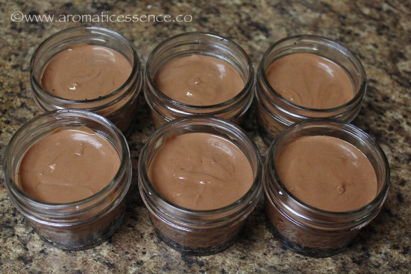chocolate cheesecake batter filled in Mason jars