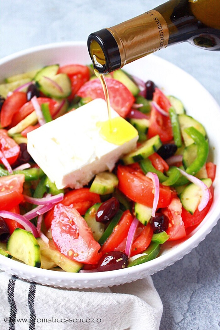 drizzling olive oil over feta cheese