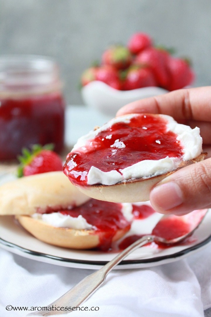 bagel with cream and strawberry jam