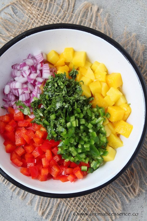 Combine the diced mangoes, bell peppers, onions, jalapeno, cilantro in a bowl.