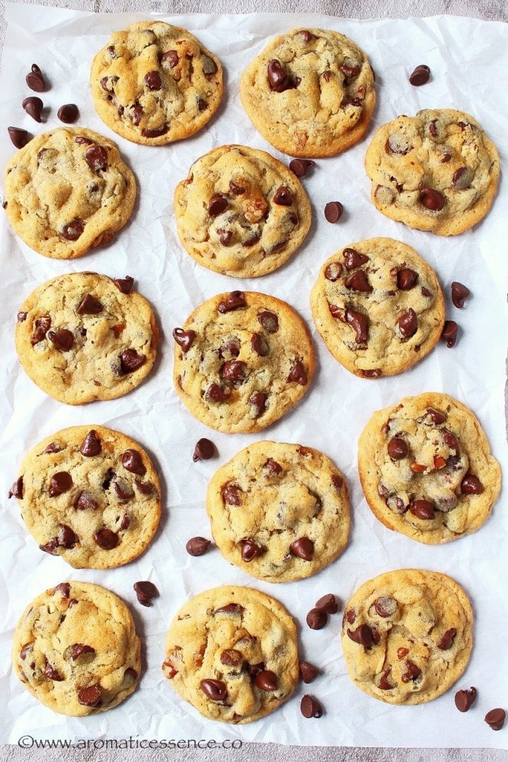 Eggless chocolate chip cookies on parchment paper.