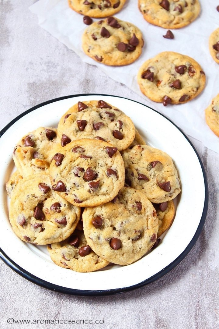Egg-free chocolate chip cookies on a white plate.