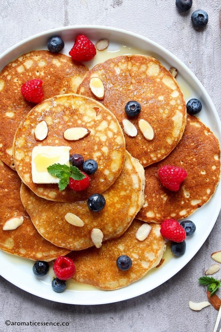 Close-up shot of almond flour pancakes served in a white rimmed plate
