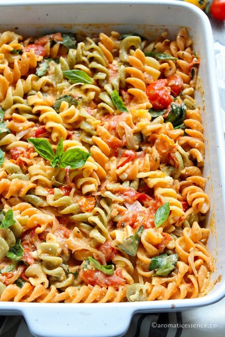 Tomato feta pasta in a white baking dish