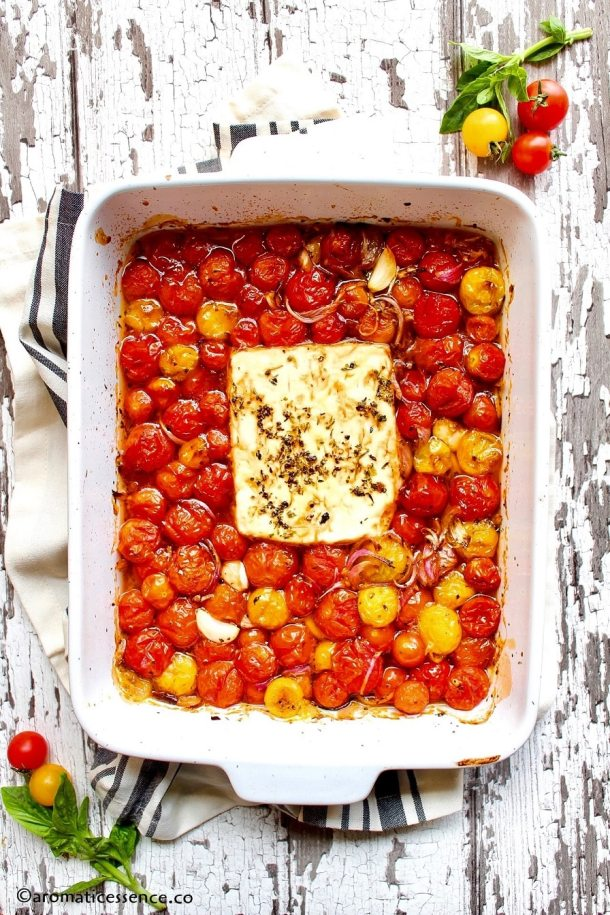 Roasted cherry tomatoes and feta cheese in a baking dish