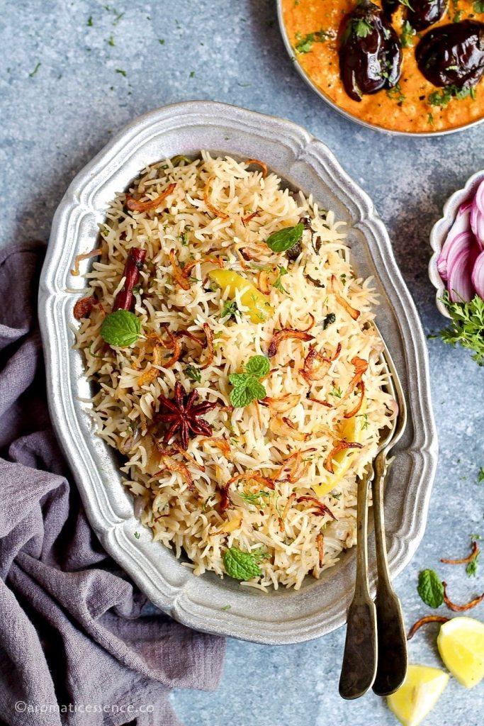 Hyderabadi bagara chawal served with bagara baingan