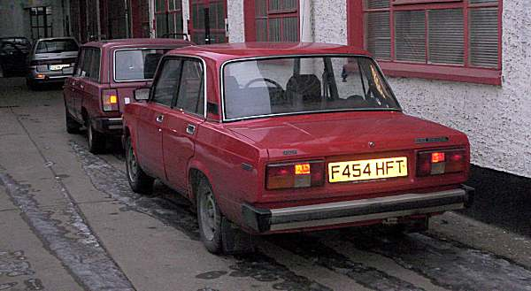 Brothers in arms: our Lada awaits the healing hands of our Berlin Lada dealer...