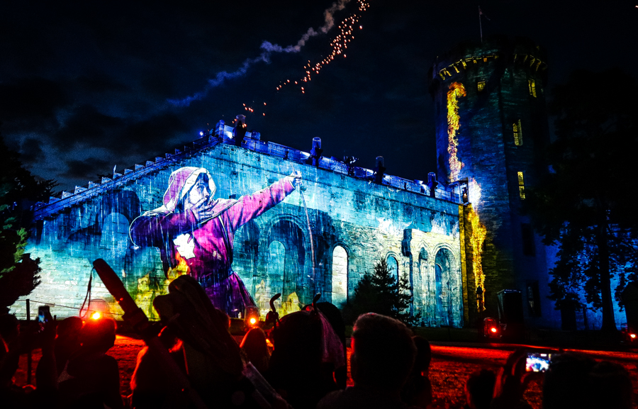 Slaying Dragons - The Castle walls are projected onto in the second act