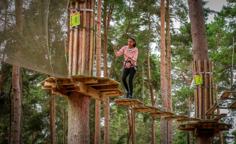 Go Ape - Shalini crossing the planks