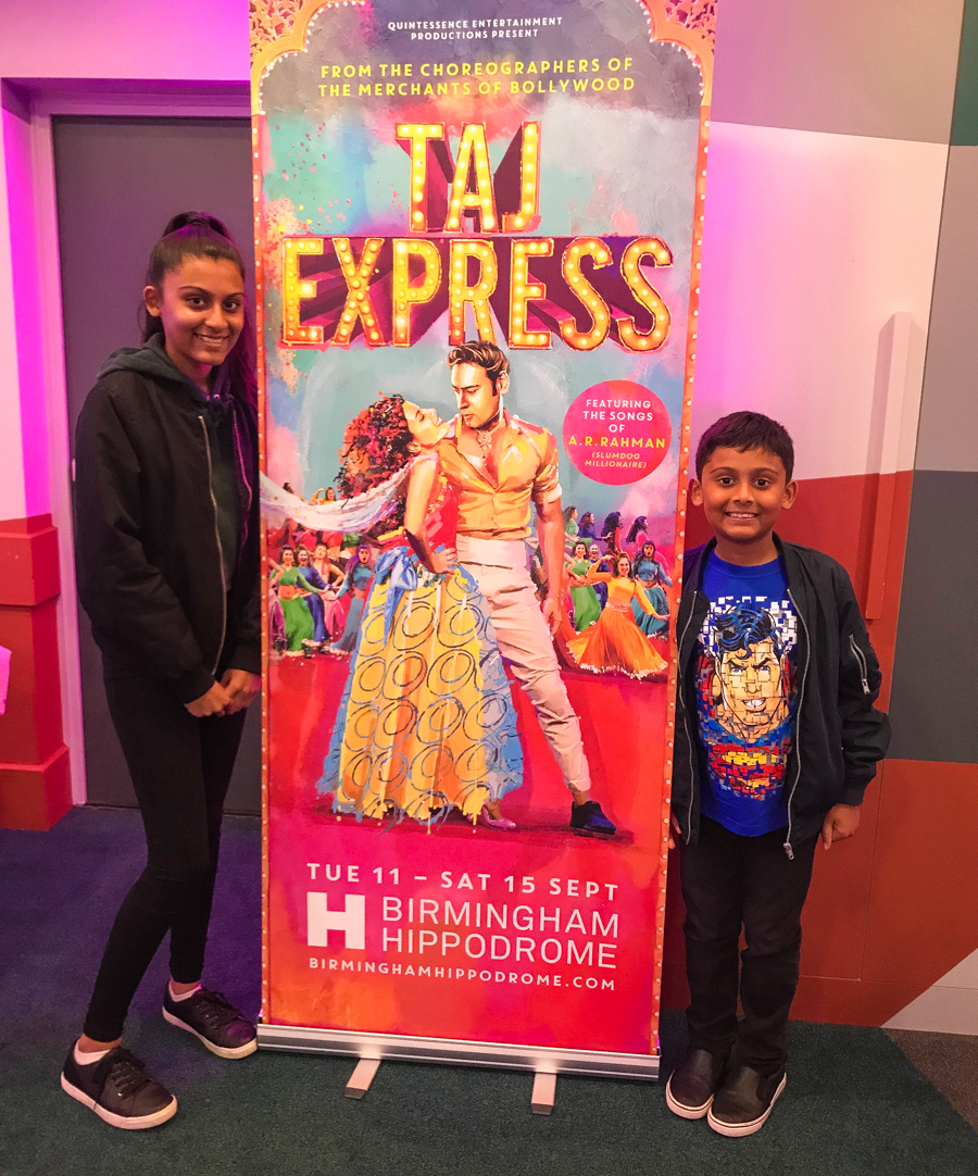 Taj Express - The kids pose by the show poster
